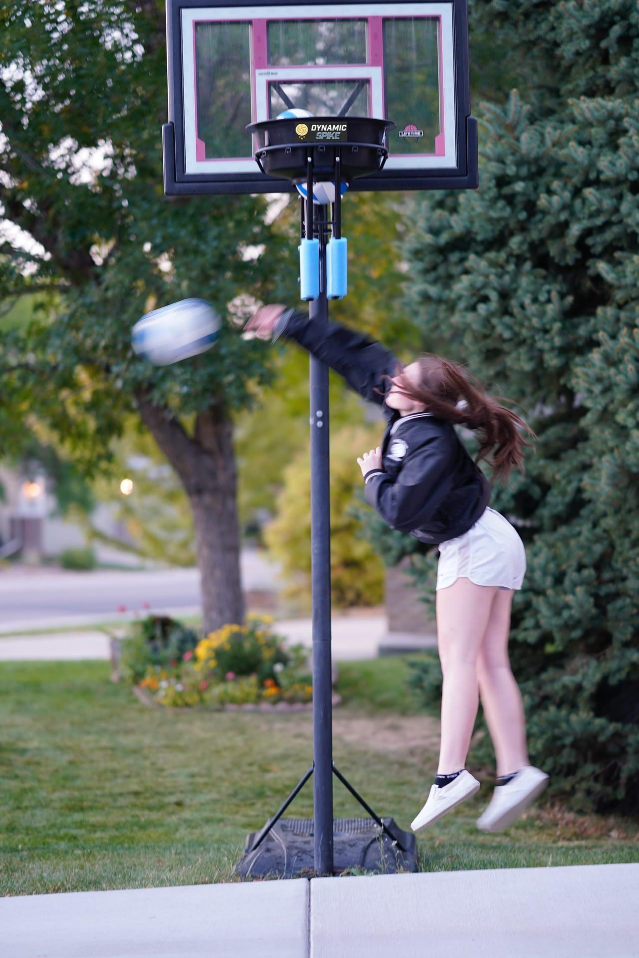 Girl hitting volleyball