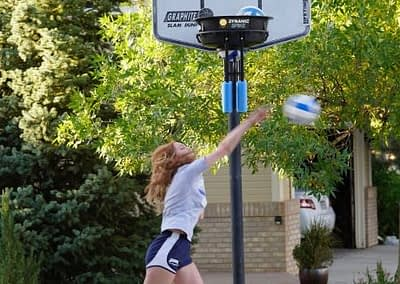 Young lady hitting with the DynamicSpike Volleyball trainer